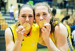 Tina Jakovina of Athlete Celje and Eva Lisec of Athlete Celje celebrate after winning during basketball match between ZKK Athlete Celje and ZKK Triglav in Finals of 1. SKL for Women 2014/15, on April 20, 2015 in Gimnazija Celje Center, Celje, Slovenia. ZKK Athlete Celje became Slovenian National Champion 2015. Photo by Vid Ponikvar / Sportida