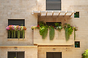 Well cared for balcony with flowerpots and pot plants Photographed in Jerusalem, Israel