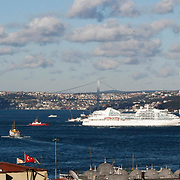 A Cruise ship and mosque in Istanbul, Turkey, the Bosphorus in the background. Photo by TURKPIX