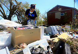 August 29, 2017 - Bayside, Texas, U.S. - LILLIAN GASCA collects valuables she found at her home after it was destroyed by Hurricane Harvey, on Tuesday. (Credit Image: © Gabe Hernandez/TNS via ZUMA Wire)