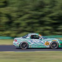 Alton, VA - Aug 26, 2016:  The Freedom Autosport Mazda MX-5 races through the turns at the Oak Tree Grand Prix at Virginia International Raceway in Alton, VA.