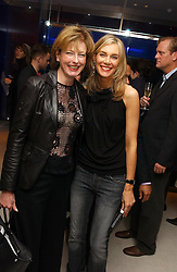 Left to right, JULIA PEYTON-JONES and KIM HERSOV at a dinner hosted by Cartier to celebrate the opening of the 2004 Frieze Art Fair, held at Yauacha 15-17 Broadwick Street, London W1 on 13th October 2004.<br /><br />NON EXCLUSIVE - WORLD RIGHTS