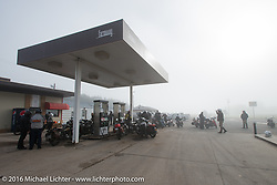 First gas stop after a brisk first leg through the fog during Stage 8 of the Motorcycle Cannonball Cross-Country Endurance Run, which on this day ran from Junction City, KS to Burlington, CO., USA. Saturday, September 13, 2014.  Photography ©2014 Michael Lichter.