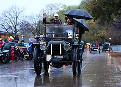 Dawn in Hyde Park, London and umbrellas at the ready as a competitors set off at the start of the London to Brighton Veteran Car Run Sunday  4th November 2012.   Photo by: Stephen Lock / i-Images