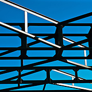 Steel structure against blue sky on sunny day