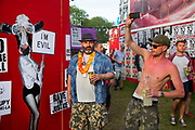 Shangri La is a festival of contemporary performing arts held each year within Glastonbury Festival. The theme for the 2015 Shangri La was Protest.  Drunken man photographing ongoing party.