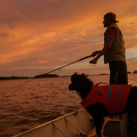 Ben Wiltsie fishes on Lake of the Woods, Ontario, accompanied by his dog Evie.