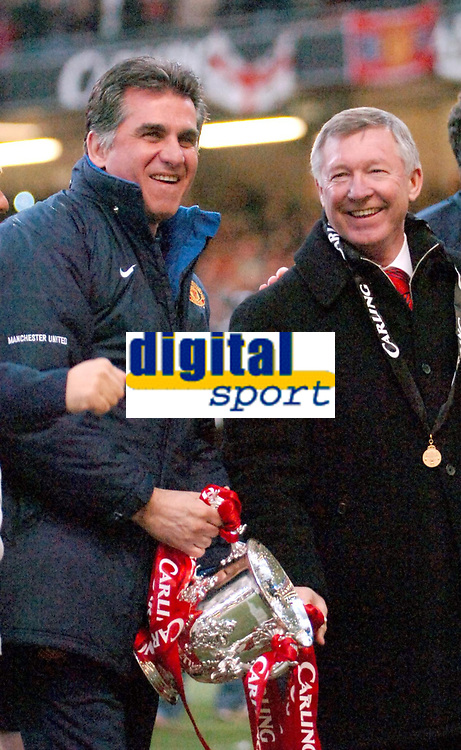 Photo: Ed Godden.<br />Manchester United v Wigan Athletic. The Carling Cup Final. 26/02/2006. Man Utd manager, Alex Ferguson (R), celebrates his teams win with Assistant coach.