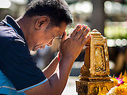 19 AUGUST 2015 - BANGKOK, THAILAND: A man prays during the reopening of the Erawan Shrine. Erawan Shrine in Bangkok reopened Wednesday morning after more than 20 people were killed and more than 100 injured in a bombing at the shrine Monday, August 17, 2015. The shrine is a popular tourist attraction in the center of Bangkok's high end shopping district and is an important religious site for Thais. No one has claimed responsibility for the bombing.     PHOTO BY JACK KURTZ