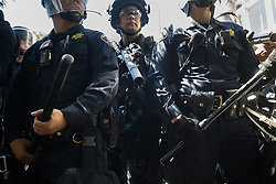 August 27, 2017 - Berkeley, California, U.S.- CHP officers stand down to an crowd that approached the across the street from MLK Jr. Civic Center Park on Sunday. (Credit Image: © Paul Kuroda via ZUMA Wire)