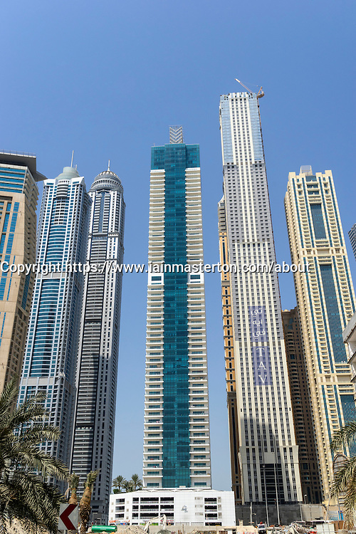 Skyline of skyscrapers with world's tallest apartment building under construction in Marina district of Dubai United Arab Emirates