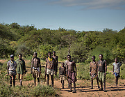 Men going hunting in the morning. At the Hadza camp of Dedauko.