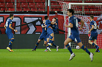 PIRAEUS, GREECE - DECEMBER 09: Players of FC Porto celebrate their second goal during the UEFA Champions League Group C stage match between Olympiacos FC and FC Porto at Karaiskakis Stadium on December 9, 2020 in Piraeus, Greece. (Photo by MB Media)