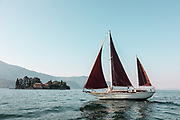 iTALY, ISEO LAKE, sailing with a traditional wooden sailing boat