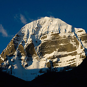 The stunning north face of holy Mount Kailash, the most sacred peak in all of Asia, at sunrise from Ditrul Phuk monastery, Tibet.