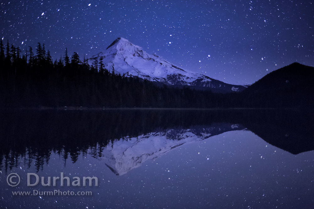 On a chilly winter night, Mount Hood and stars are reflected in Lost Lake. Mount Hood National Fores, Oregon. © Michael Durham / www.DurmPhoto.com.
