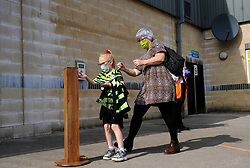 Forest Green Rovers fans sanitise their hands before entering the stadium- Mandatory by-line: Nizaam Jones/JMP - 19/09/2020 - FOOTBALL - New Lawn Stadium - Nailsworth, England - Forest Green Rovers v Bradford City - Sky Bet League Two
