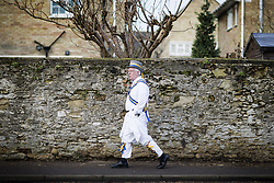 January 14, 2017 - Whittlesey, Cambridgshire, UK - Whittlesey UK. Picture shows a member of the Peterborough Morris dancers at the 38th Whittlesey Straw Bear Festival this weekend. In times past when starvation bit deep the ploughmen of the area where drawn to towns like Whittlesey, They knocked on doors begging for food & disguised their shame by blackening their faces with soot. In Whittlesey it was the custom on the Tuesday following Plough Monday to dress one of the confraternity of the plough in straw and call him a Straw Bear. The bear was then taken around town to entertain the folk who on the previous day had subscribed to the rustics, a spread of beer, tobacco & beef. The bear was made to dance in front of houses & gifts of money, beer & food was expected. (Credit Image: © Andrew Mccaren/London News Pictures via ZUMA Wire)