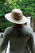 female person wearing a straw hat