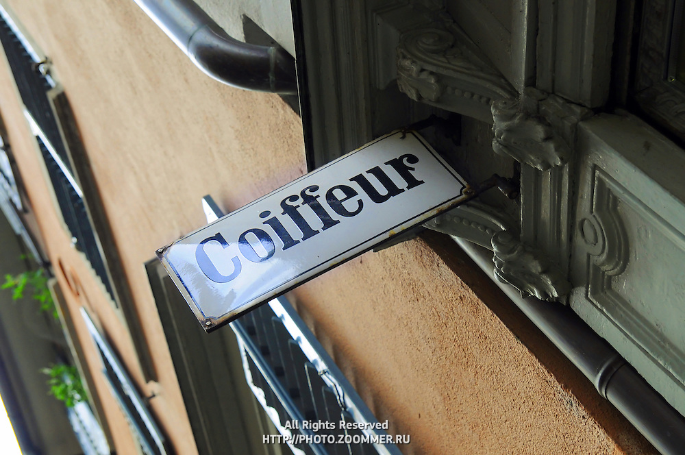 Coiffeur sign on hair salon in Switzerland