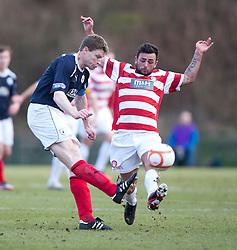 Falkirk's Darren Dods and Hamilton's Gary Fisher..half time : Hamilton v Falkirk, Scottish Cup quarter-final, Saturday, 2nd March 2013..©Michael Schofield.