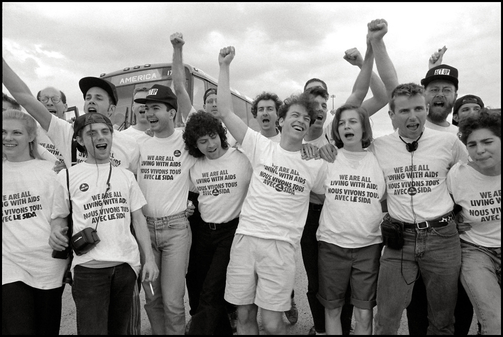 AIDS Activists from ACT UP NY en route to Montreal where they stormed the Fifth International AIDS Conference in Montreal, at the time a members-only event for doctors and HIV/AIDS researchers. They took over seats reserved for dignitaries, and released their first Treatment and Data report calling for speedier access to AIDS drugs. June 4, 1989