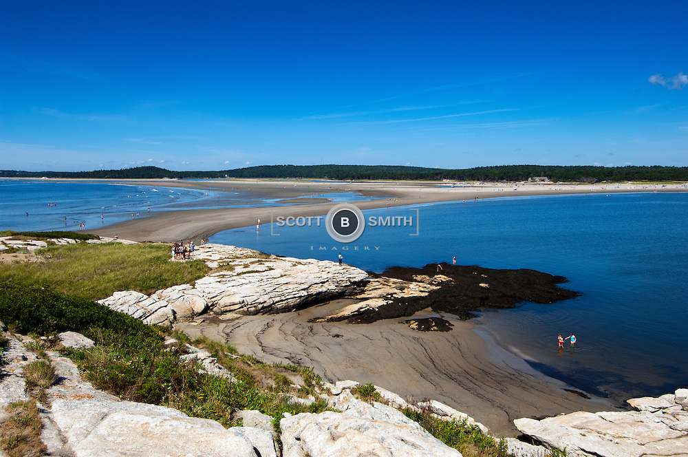 Popham Beach State Park Maine- A DYNAMIC AND CHANGING LANDSCAPE - Sand movement and beach dynamics have had a dramatic effect on Popham Beach, causing extreme shoreline change and dune erosion.<br /> Bordering the south side of the mouth of the Kennebec River, Popham Beach State Park is truly one of Maine's rare geologic landforms that features a long stretch of sand beach. Sunbathers relaxing on Popham's sands can see Fox and Wood islands offshore, and the Kennebec and Morse rivers border each end of the beach. Visitors can walk to Fox Island at low tide, but are warned to pay attention to the rising tides not to get marooned.