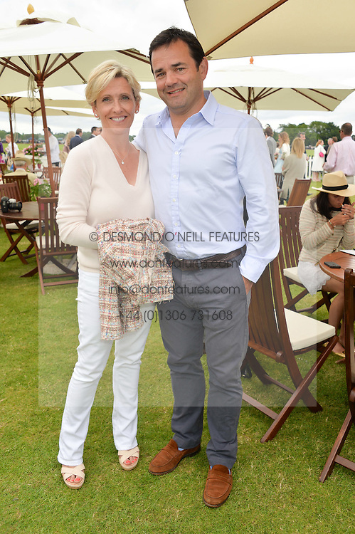 WILL & LISA CARLING at the Cartier Queen's Cup Final polo held at Guards Polo Club, Smith's Lawn, Windsor Great Park, Egham, Surrey on 15th June 2014.