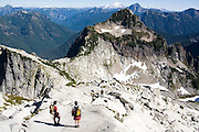Climbers stand below the summit of Vesper Peak, North Cascades, Washington.