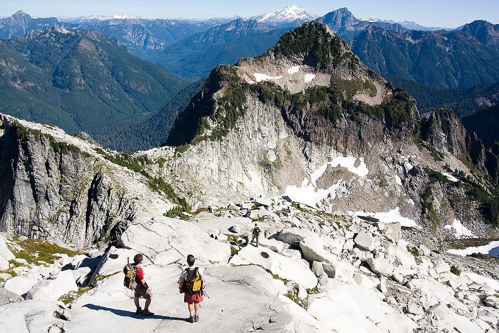 Climbers stand below the summit of Vesper Peak, North Cascades, Washington.