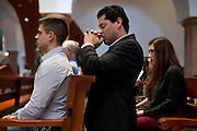 Juan Enriquez kneels down in prayer before mass at St Ann Catholic Parish in Coppell, Texas on October 12, 2014. (Cooper Neill for The New York Times)