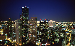 Stock photo of a nighttime view of downtown Houston skyline buildings.