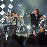 """WASHINGTON, DC - July 25, 2014 - Brian Kelley and Tyler Hubbard of Florida Georgia Line perform at Nationals Park in Washington, D.C. as part of Jason Aldean's Burn It Down Tour. The duo have had multiple singles top the US Country charts, including """"Cruise"""" and """"This is How We Roll."""" (Photo by Kyle Gustafson / For The Washington Post)"""
