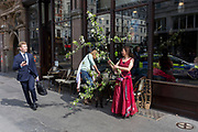 A businessman dodges the brances of a hawthorn branch carried by an activist from the closed Waterloo Bridge on day 4 of protests by climate change environmental campaigners with pressure group Extinction Rebellion, on18th April 2019, in London, England.