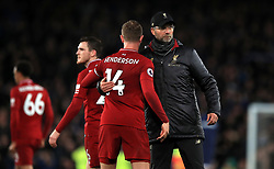 Liverpool manager Jurgen Klopp (right) and Jordan Henderson after the final whistle during the Premier League match at Goodison Park, Liverpool.