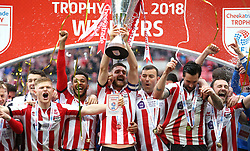 Lincoln City's Luke Waterfall lifts the Checkatrade Trophy