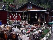"Nick-nacks decorating yard of ""Soul Sea Se"" cabin in Mogollon, New Mexico."