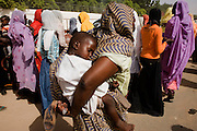 Local Darfurian women leave the compound belonging to the North Darfur Govenor during the first-ever international Conference on Womens' Challenge in Al Fasher (also spelled, Al-Fashir) where the women from remote parts of Sudan gathered to discuss peace and political issues.