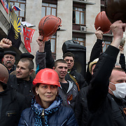 A group of coal miners celebrate as they announce their support to the pro-Russia activists occupying Donbass Regional Government building in central Donetsk. Barricades around the building, occupied since the past weekend, have been fortified throughout the day, as the ultimatum given by the government in Kiev for the activists to abandon the building within 48 hours, is approaching its deadline.