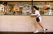 A roller skating waitress delivers an order at a drive-thru restaurant in Modesto, California, USA