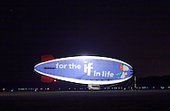 Montgomery, NY  - The MetLife blimp Snoopy Two is illuminated at night at Orange County Airport on July 25, 2008.