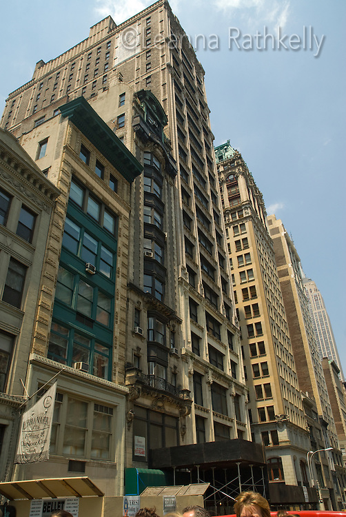 Buildings reflect art deco styling at the corner of East 27th and 5th Avenue, New York City, NY, USA.