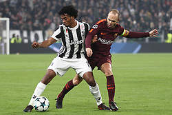 November 22, 2017 - Turin, Italy - Juventus midfielder Juan Cuadrado (7) fights for the ball against Barcelona midfielder Andres Iniesta (8) during the Uefa Champions League group stage football match n.5 JUVENTUS - BARCELONA on 22/11/2017 at the Allianz Stadium in Turin, Italy. (Credit Image: © Matteo Bottanelli/NurPhoto via ZUMA Press)