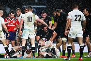 New Zealand's Charlie Faumuina gets up after having finished off the drive from New Zealand's Ryan Crotty - QBE Autumn Internationals - England vs New Zealand - Twickenham Stadium - London - 08/11/2014 - Pic Charlie Forgham-Bailey/Sportimage