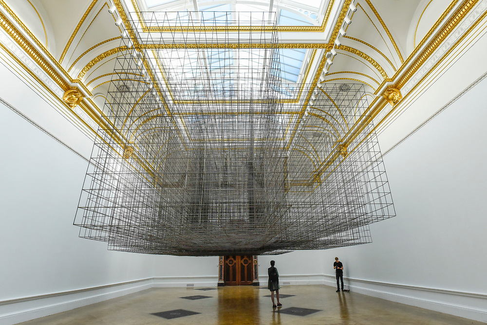 """© Licensed to London News Pictures. 17/09/2019. LONDON, UK. Visitors view """"Matrix III"""", 2019, by Antony Gormley, 6 tonnes of steel reinforcing mesh. Preview of a new exhibition by Antony Gormley at the Royal Academy of Arts.  The show bring together existing and specially conceived new works from drawing to sculptures to experimental environments to be displayed in all 13 rooms of the RA's Main Galleries 21 September to 3 December 2019.  Photo credit: Stephen Chung/LNP"""
