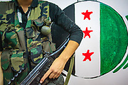 A member of the Free Syrian Army (FSA) armed forces appear to hold and pose for a picture with a Swiss-made hand grenade in Marea on Sunday, July 1, 2012. The box holds the following ID numbers: 4A/Y21/S/03, CH/EGI-3932/RM, under title Grenades UN 0285. (Photo by Vudi Xhymshiti)