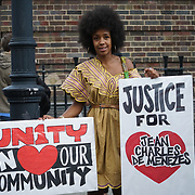 Tottenham cPolice Station, London, UK. 4th August 2017. Jabu Maseko of the Revolutionary socialist attend Justice for Mark Duggan protest march for the 6th Anniversary Vigil.