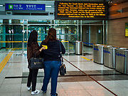 PAJU, GYEONGGI, SOUTH KOREA: South Korean tourists look at the departure gate for trains to North Korea at Dorasan Station on the South Korean edge of the DMZ. The station was built in the early 2000s during a thaw in relations between the Koreas. It has never been used and is now a tourist site. Tourism to the Korean DeMilitarized Zone (DMZ) has increased as the pace of talks between South Korea, North Korea and the United States has increased. Some tours are sold out days in advance.      PHOTO BY JACK KURTZ