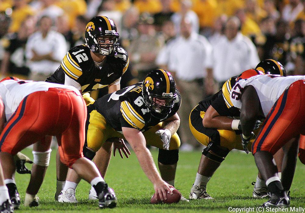 08 SEPTEMBER 2007: Iowa quarterback Ricky Stanzi (12) lines up under center Iowa center Travis Meade (61) in Iowa's 35-0 win over Syracuse at Kinnick Stadium in Iowa City, Iowa on September 8, 2007.