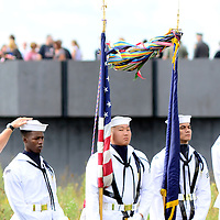 A member of the U.S. Parks Service returns the cap that has blown off the head to a member of the color guard during the ceremony to observe the15th anniversary of  the the crash  of  Flight 93 at the visitor center of the Flight 93 Memorial on September 11, 2016.  Photo by Archie Carpenter/UPI